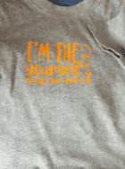 Boys grey top ( I'm the youngest ) t shirt orange font
