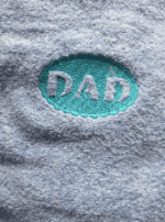 Embroidered embossed dad logo towel